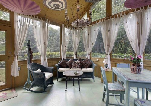 Porch in luxury home with wihte curtains